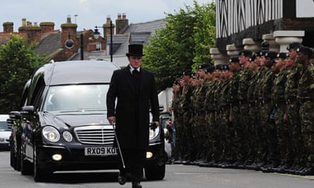 British soldiers killed in combat in Afghanistan are driven in a cortege through Wootton Bassett