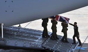 The coffin of Daniel Hume is carried from an aircraft during a repatriation ceremony at RAF Lyneham