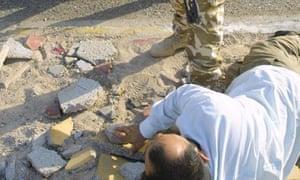 British soldiers arrest an Iraqi in Basra, July 2003