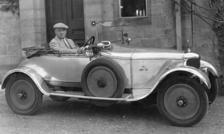 PG Wodehouse in his car outside his house, 1928