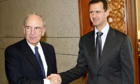 George Mitchell shakes hands with Bashar Assad