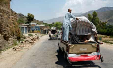 The family of Bakht Biland travel through the Swat Valley on their way to their home in Mingora