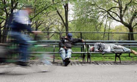 Homeless men sleep on park benches May 2, 2007 in New York City