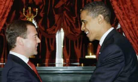 President Barack Obama shakes hands with Russian President Dmitry Medvedev