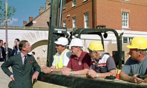 Prince Charles talking to construction workers in Poundbury
