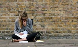 A pupil checks her A-level exam results
