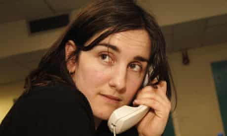 Woman on phone makes personal call at work