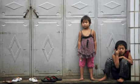 Young refugees from Kokang in Burma wait to be processed by Chinese authorities