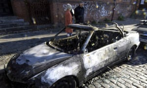 A burned-out car in Berlin, 7 November 2005