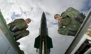 Russians soldiers sit on the launcher of a Tochka-M short range missile