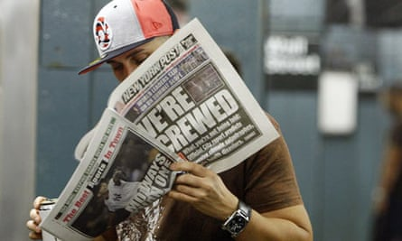 A man reads a fake edition of the New York Post