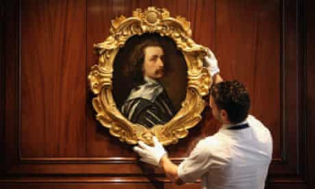 A Sotheby's employee with a painting by Sir Anthony Van Dyck