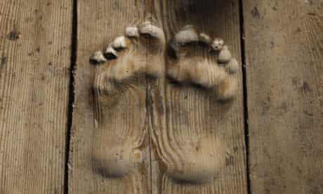 Footprints carved in wood