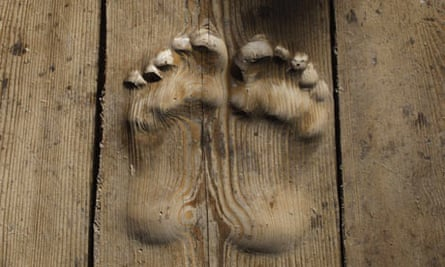 Footprints carved in wood
