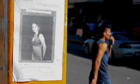 A picture of 15 year-old girl stares out from a poster in downtown Ciudad Juarez, Mexico