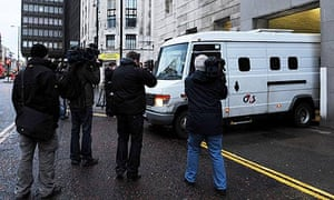 A van transporting PC Stephen Mitchell leaves court in Newcastle.