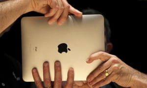 """Members of the technology media try out Apple's  """"iPad"""" after its launch event in San Francisco"""