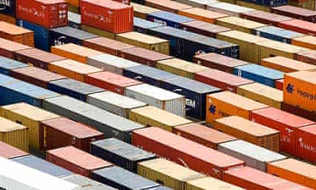 exports containers sit on dockside at Tilbury Docks, U.K., on Mo