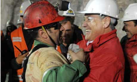 Rescuedminer Florencio Avalos (left) hugs Chilean President Sebastian Pinera