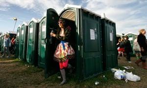 A festival-goer leaves the toilets at Glastonbury, 2008