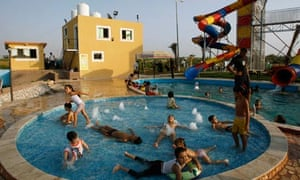 Palestinian children play in a pool at Crazy Water Park in August