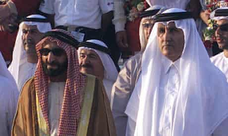 The late ruler Sheikh Saqr with Sheikh Khalid