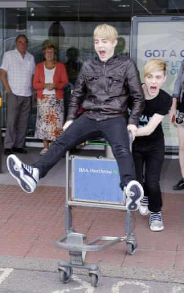 Jedward arrive at Heathrow airport