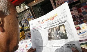 An Iraqi man reads newspaper with news on the Wikileaks documents in Baghdad.