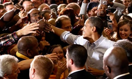 U.S. President Barack Obama shakes hands at a campaign rally in Minneapolis