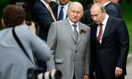 Yuri Luzhkov with Vladimir Putin at a war memorial ceremony in May this year.