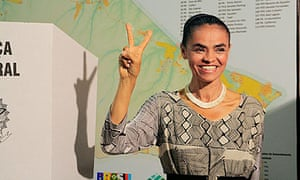 Marina Silva of the Green party poses after voting in Rio Branco, in the Amazon region of Brazil.