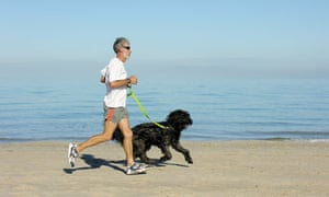 A man jogging with his dog