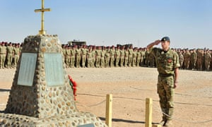 Prince William salutes the memorial to the British Soliders killed in Afghanistan