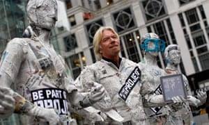 Virgin Group head Richard Branson stands outside New York City's flagship Apple store