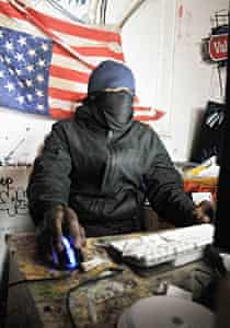 A 'hacktivist' claiming to be participating in 'Operation Payback, in New York.