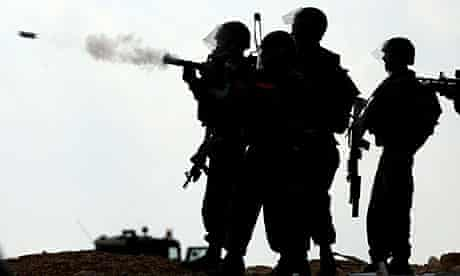 Israeli soldiers fire tear gas at protesters at a demonstration in the West Bank village of Bilin