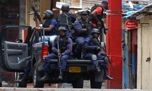 Jamaican police patrol Kingston Jamaica