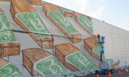 Workmen cover up Blu's mural