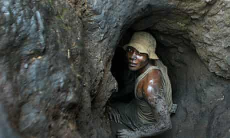 A worker at a uranium mine in the DRC