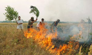 Russians attempt to put out a fire during a month-long heatwave, summer 2010