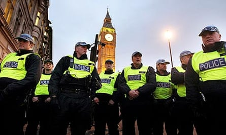 Police officers stand guard outside parliament during the recent student protests.