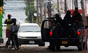 Armed police question men in Tivoli Gardens, Kingston