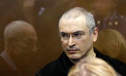 Mikhail Khodorkovsky stands in the defendants' cage