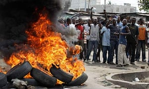 Supporters of opposition candidate Alassane Ouattara  burn tyres in Abidjan, Ivory Coast.