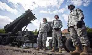 US soldiers stand in front of a Patriot missile battery