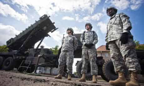 US soldiers stand in front of a Patriot missile battery at an army base in the Polish town of Morag
