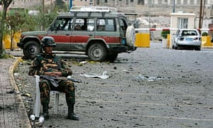 A Yemeni soldier guards the US Embassy in San'a days after it was attacked by militants