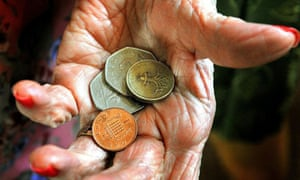 Money in the hand of a pensioner