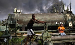 Children play on an abandoned Shell oil flow station in Kegbara Dere, Nigeria.