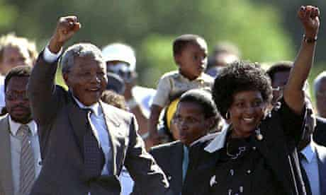 Nelson Mandela is accompanied by his wife Winnie, after his release from Victor Verster prison